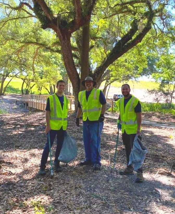 United Way Central Florida cleaning up trash in the Park on Earth Day